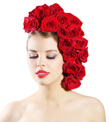 Portrait of smiling girl with red roses hairstyle isolated on wh