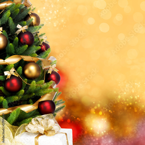 Magically decorated Christmas Tree with balls, ribbons and golde