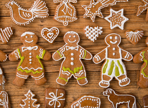 Gingerbread happy creatures on wood