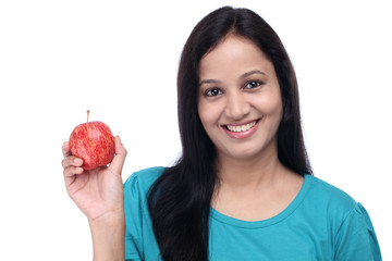 Young Indian girl with red fresh apple