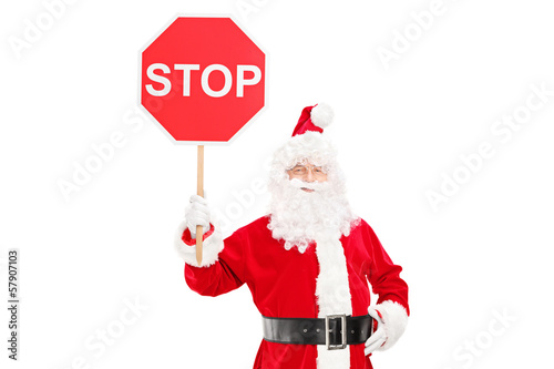 Smiling Santa Claus holding a stop sign