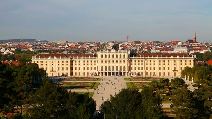 Schonbrunn palace at sunset with tourists in Vienna
