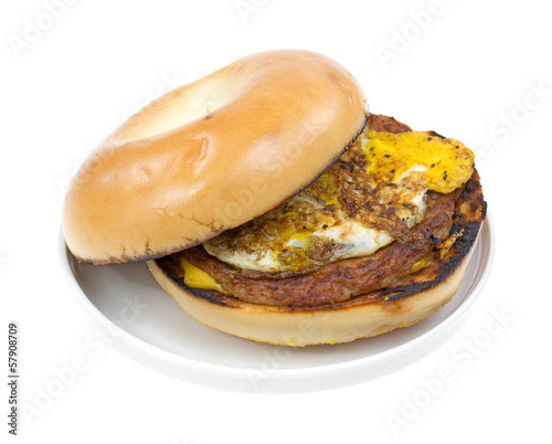 Bagel with sausage breakfast sandwich on a plate