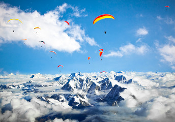 Paraglider flying against the Himalayas-Everest region, Nepal