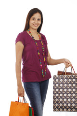 Happy Indian woman with shopping bags