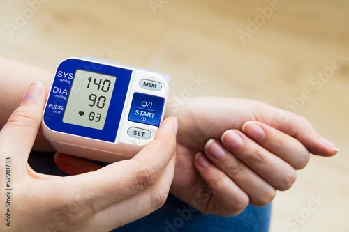 canvas print picture High blood pressure. woman measures the pressure