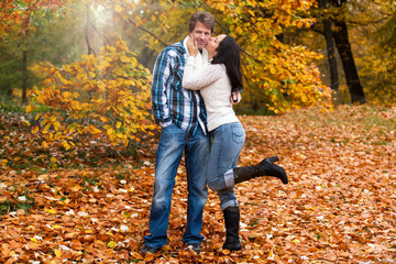 Happy couple in a park in autumn