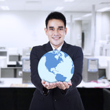 Asian businessman holding globe