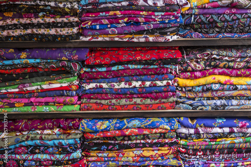 Colurful scarfs on shelves