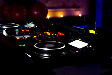 Music deck and turntables at a discotheque