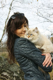 Siberian cat and young woman