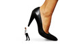 small man under big heel
