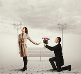 woman rejecting man with flowers
