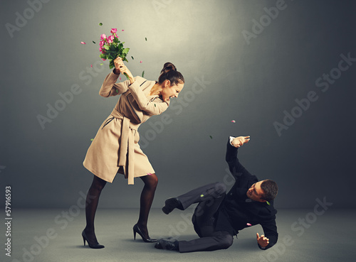 woman yelling at frightened man