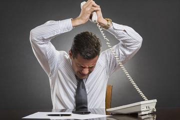 Businessman losing temper control during a phone conversation