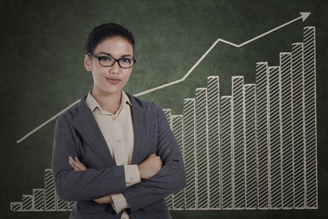 Confident businesswoman with growth graph