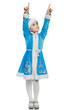 Little girl in blue suit of snow maiden pointing up