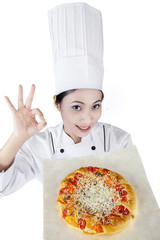 Female chef holding a pizza