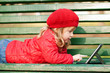 Happy little girl  with tablet pc