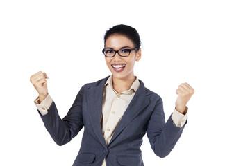 Happy businesswoman showing success
