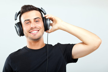 Young man listening to music with earphone