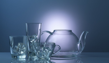 the glass teapot with cup