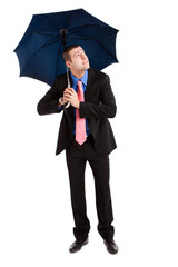 Businessman under an umbrella isolated on white