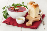 Red borsch with traditional Ukrainian bread pampushki