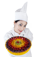 Pretty woman chef holding a cake
