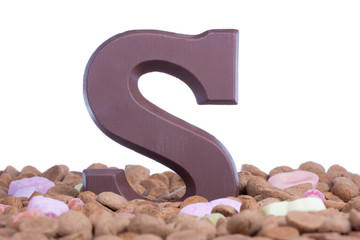 Ginger nuts with chocolate letter S at Dutch event Sinterklaas
