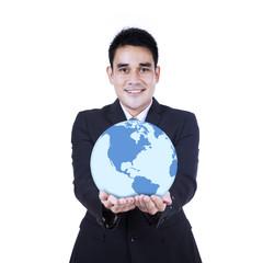 Smiling businessman holding a globe