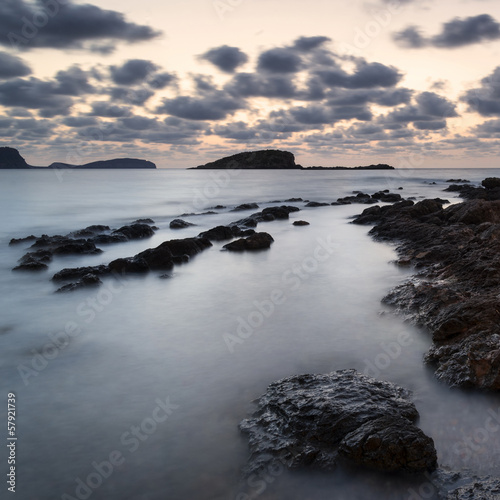 Stunning landscapedawn sunrise with rocky coastline and long exp © veneratio