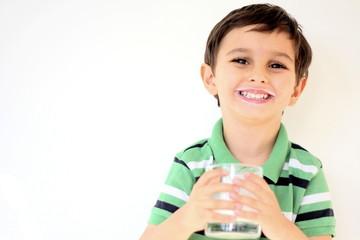 happy little boy with white moustache drinking milk