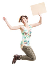 Beautiful woman jumping and holding a cardboard