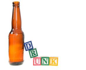 Letter blocks spelling drunk with a beer bottle