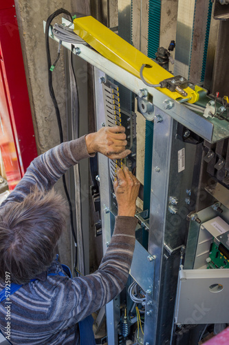 Installing Traveling Cable, elevator parts installation