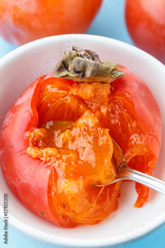 persimmon with spoon, close up - kaki