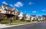 Street of large suburban homes poster