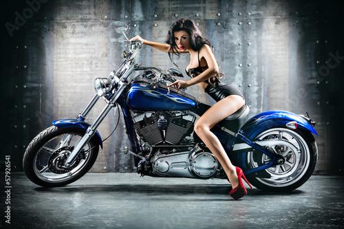 Young sexy woman sitting on motorcycle. © Sergii Figurnyi