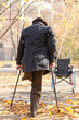 Handicapped one-legged man walking on crutches