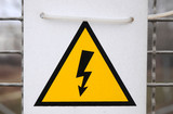 electricity warning sign - black lighting on yellow triangle poster