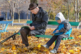 Young boy reading with his grandfather