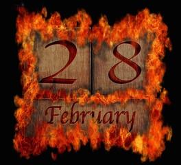 Burning wooden calendar February 28.
