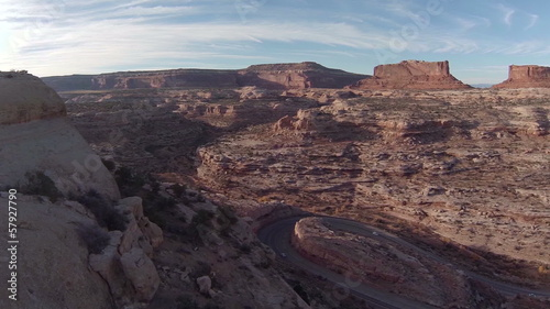 Aerial flying by switchback road and mountainside southern Utah