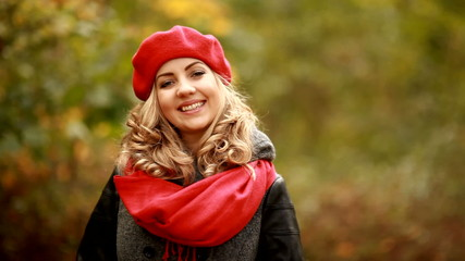 Portrait of beautiful blond girl in park