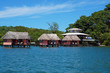 Eco resort with thatched bungalow over water