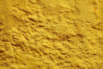 Yellow paint wall background or texture