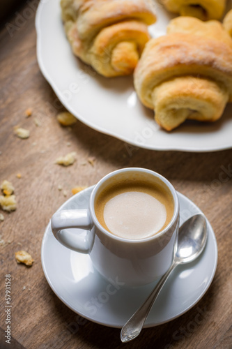 Breakfast with espresso and a fresh croissant