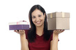 Young smiling woman with gift boxes