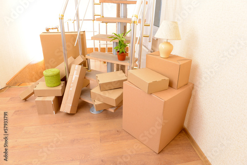 Stack of cartons near stairs: moving house concept